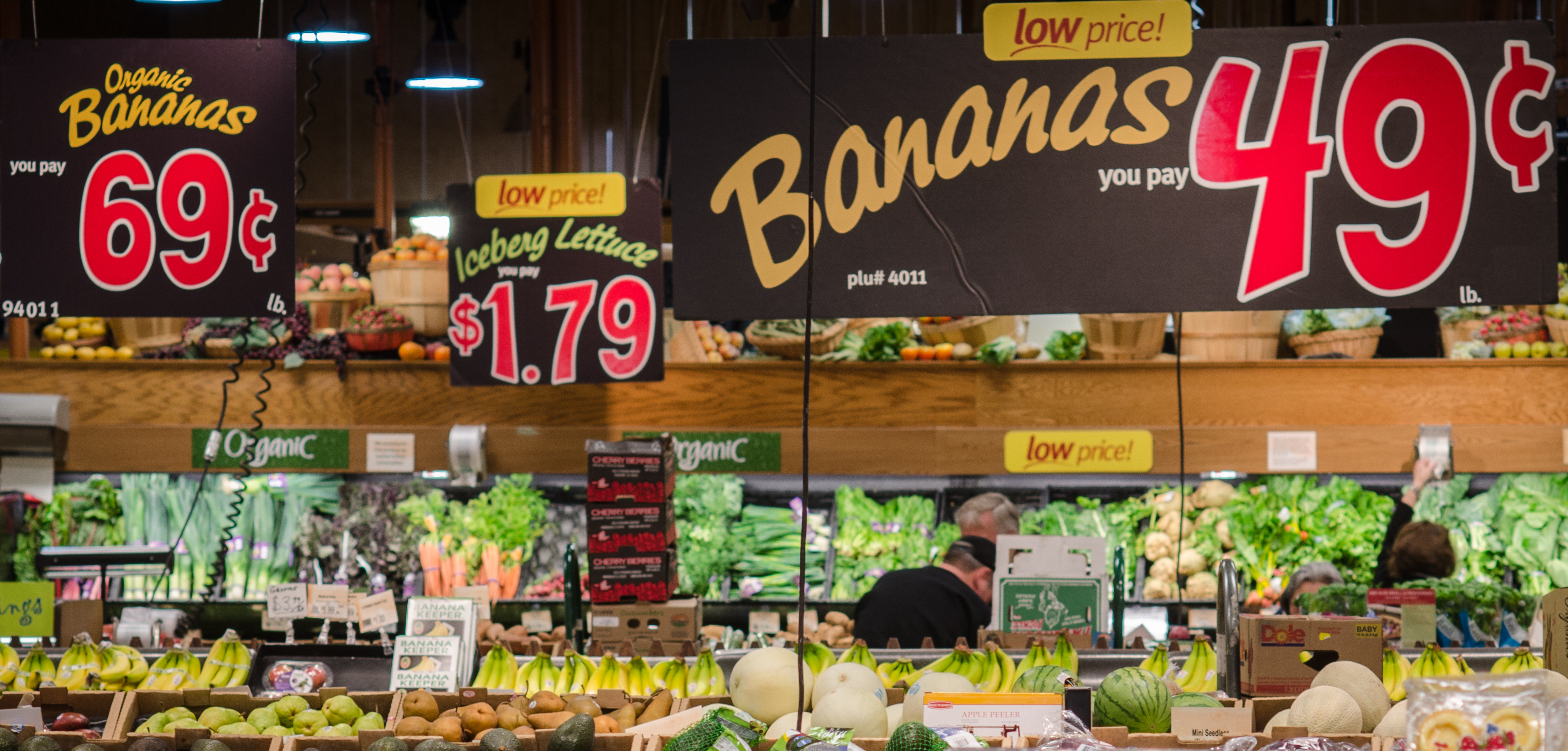 Produce section at a grocery store in Virginia. Bananas on display are 49 cents a pound for conventional or 69 cents a pound for organic.