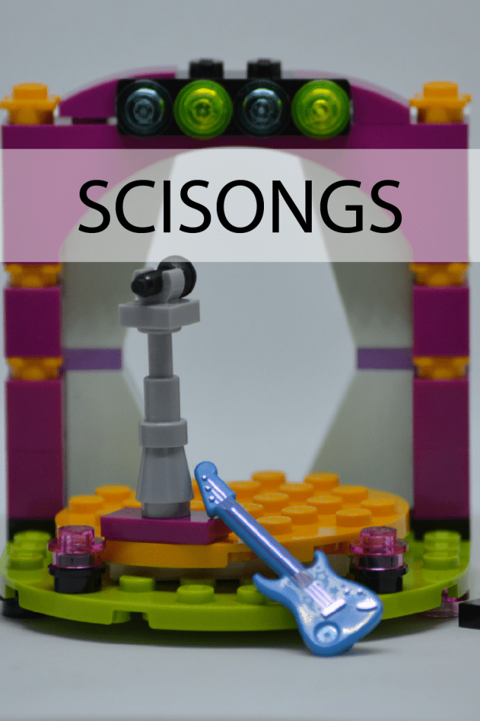 Brightly colored rock and roll stage with speakers, sheet music, electric guitar, microphone stand, and lights - all made out of lego bricks. With the word SCISONGS across the top.